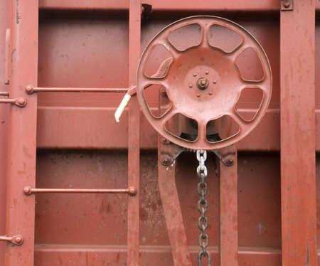 Isolated railroad equipment iron on boxcar photo
