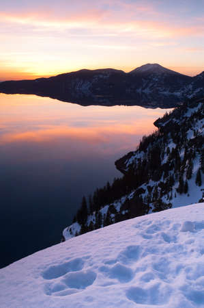 The sun comes up to light the scene at crater lake photo
