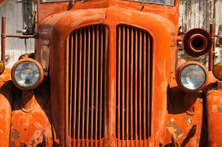 Firetruck rusts in the summer sun photo