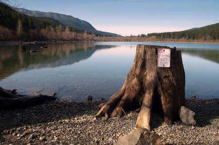 needless: Seemingly needless spot for a no parking sign at lakeshore Stock Photo