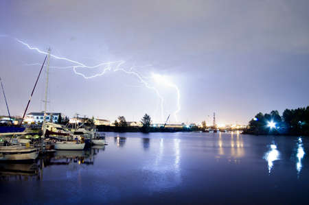 Lightning strikes over the water and marina in Tacoma Stock Photo - 22762629