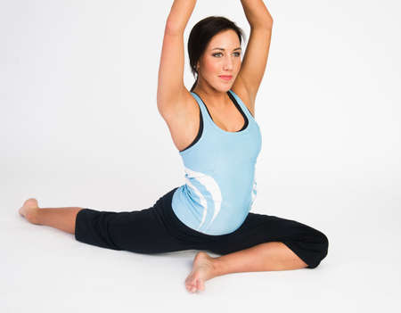 Attractive young woman shows how flexible she really is