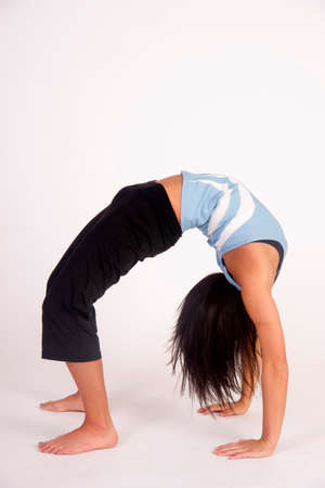Flexible young woman bent over backwards photo