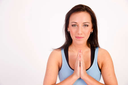 Young woman practicing Yoga meditation isolated on white photo