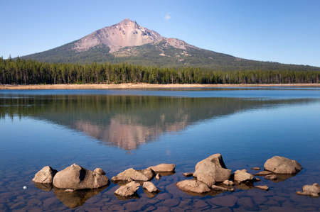 mile: Four Mile Lake shows a nearly perfect reflection for Mt McLoughlin