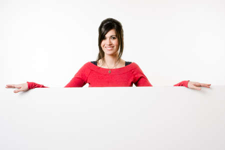 Woman smiles at she stands in between white spaces photo