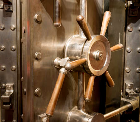 bank protection: Door of big vintage safe in retail store Stock Photo