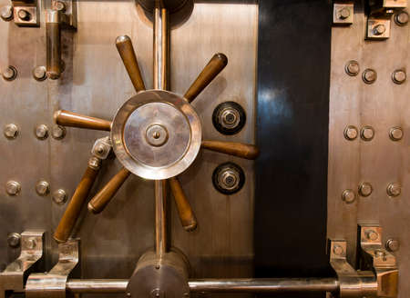 Locked bank vault door in retail store photo