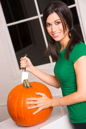 Woman preap Pumpkin for Halloween photo