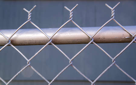 wire mesh: The chain link fence in my own backyard Stock Photo