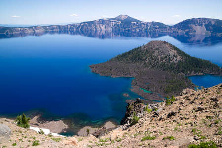 Wizard Island is a volcanic cinder cone which forms an island at the west end of Crater Lake photo