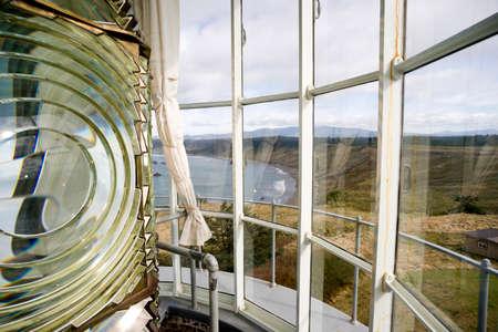 Spinning Fresnel Lens housing in Cape Blanco Lighthouse tower Imagens
