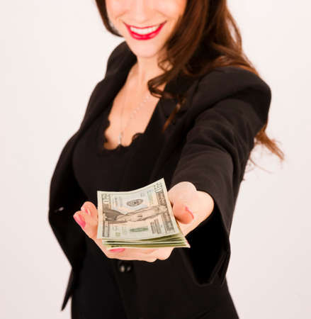 Brunette wokman in a business suit holds out some cash to the viewer photo