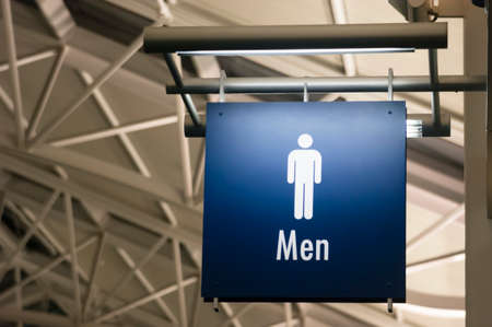 l boy: The Sign for Mens Lavatory Male Bathroom in a Public Building Business Place Stock Photo