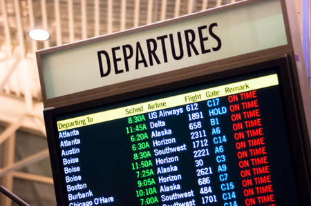 arrivals: Larger than Life Size Depature Schedule Sign at Local Airport Flight Center