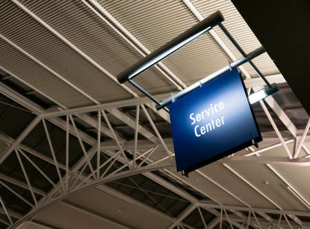 blue signage: Blue Signage Marks the Customer Service Center in a Public Building Shopping Structure Stock Photo