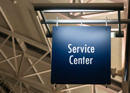 blue signage: Blue Signage Marks the Customer Service Center in a Public Building Shoipping Structure Stock Photo