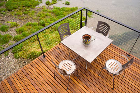 Wood Plank Deck Patio Beach Water Stainless Steel Dining Set Stock Photo - 23549941