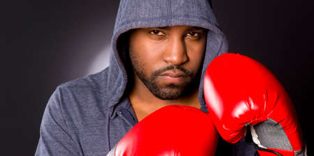 African Anerican male boxer poses for a boxing portrait photo