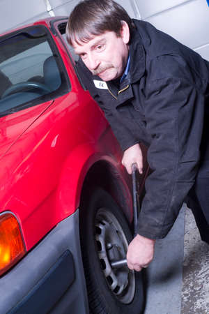 lugs: Ed loosens the lugs so he can remove the tire to check brakes