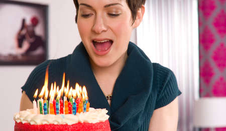 Bithday candles burns right before woman blows them out photo