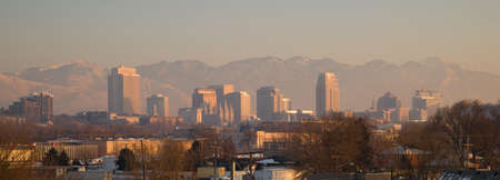 Salt Lake City with the Wasatch Mountain Range showing through the pollution photo