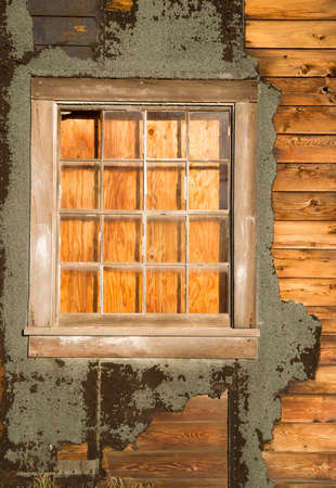 downtrodden: A structure photographed from the outsdie has been boarded up from the inside Stock Photo