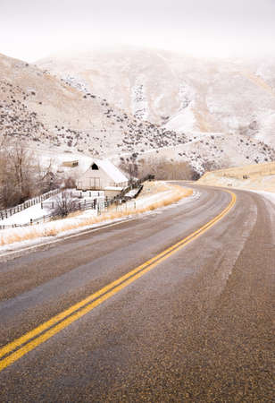 slick: An icy road leads through country scene farm ranch hillside highway 71