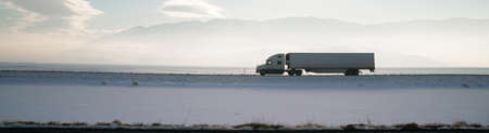 Long horizontal panoramic Over the Road Trucking in the Great Basin
