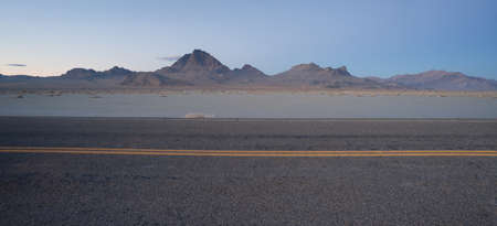 rewarded: This highway carries much traffic from Utah into Nevada and travelers are rewarded with this scene Stock Photo