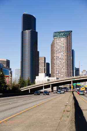 Vehicles travel down Interstate 5 in front of Seattle Downtown photo