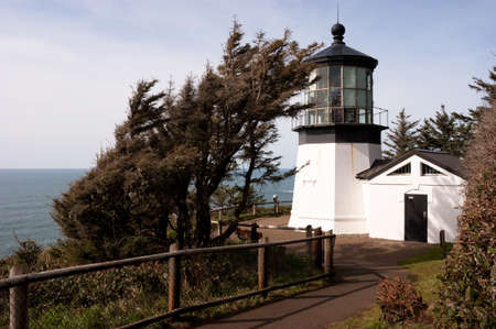 guard house: A footpath leads down to the lighthouse on a sunny day Stock Photo