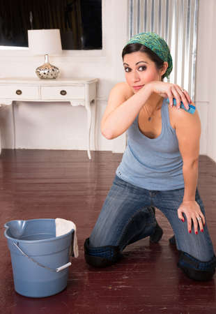 A woman gets tired of cleaning the floor by hand