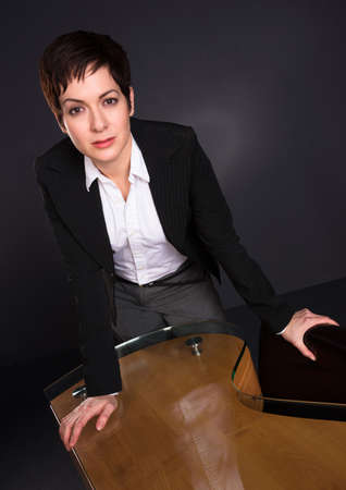 Business woman standing grey background