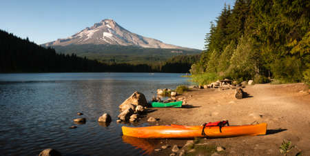 Kayaks beached on the shore of an Oregon Lake photo
