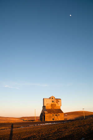 An Old Agricultural Structure Still Stands while the sun sets Stock Photo