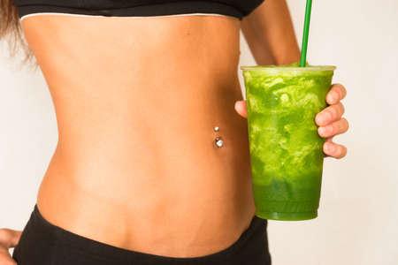 Slender Female Torso Tanned Toned Body Blended Fruit Smoothie Drink