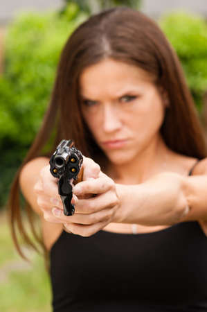 Angry Beautiful Brunette Woman Points Loaded Handgun Self Defense photo