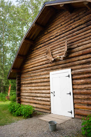 Rustic Log Out Building Moose Antler Rack Alaska Outback photo