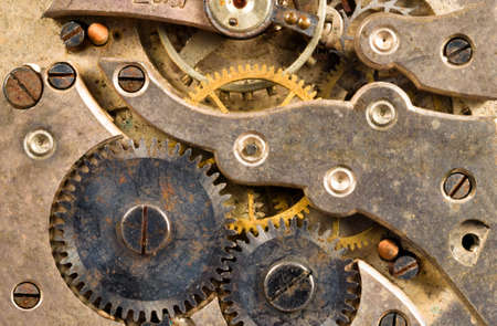 Extreme close up of the inside workings of a jeweled pocket watch time piece photo