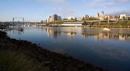 The sun rises hitting the buildings of North Tacoma Washington United States
