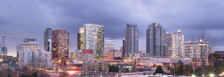 A clear panoramic view of Bellevue, WA with a storm passing at dusk Foto de archivo