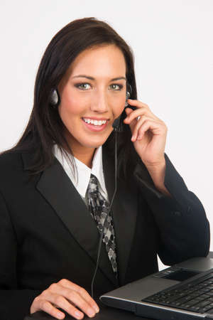 service occupation: Woman in business suit smiles while working the phones at Customer Service Occupation