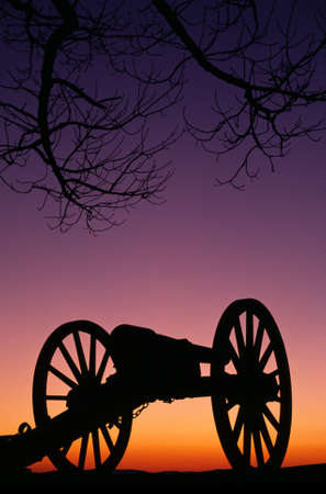 Relics from prior American War sit in the sunset photo
