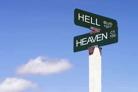 Heaven Hell Signs Crossroads Street Avenue Sign Blue Skies Clouds photo