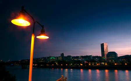 eastbank: A dtreet lamp illuminates the scene on the waterfront in Portland Stock Photo