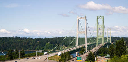 puget sound: The Tacoma Narrows Bridge carried drivers form the mainland to Gig Harbor and the Olympic Peninsula.
