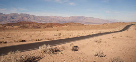 valley below: Badwater Road meanders through Death Valley below sea level only sees 2\ of rain a year Stock Photo