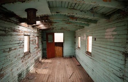 caboose: The view inside an abandoned railroad caboose car Stock Photo