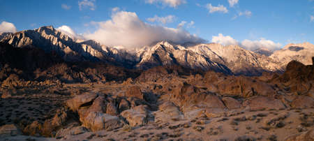 high sierra: White clouds make a perfect backdrop to bounce color down into this landscape Stock Photo